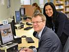 Trafford Executive Councillor Alex Williams (left) with the council's ICT Project Manager Nasrin Fazal